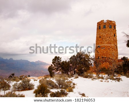 Desert view watchtower at Grand Canyon right before a snow storm arrives - stock photo
