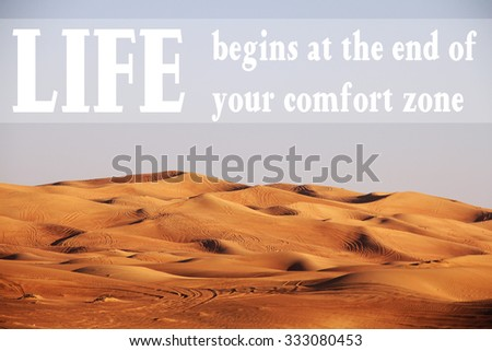 Desert with text: Life begins at the end of your comfort zone - stock photo