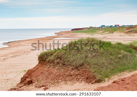Deserted beach on the north shore of Prince Edward Island, Canada. - stock photo