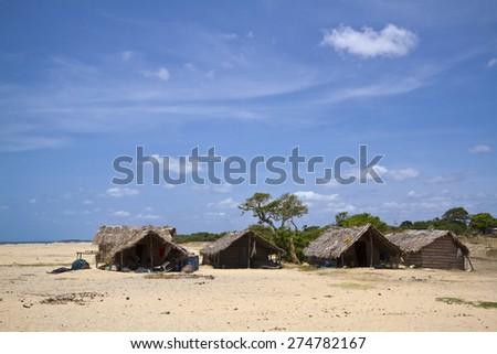 Deserted beach with fishermen hut in Polmoddai, Sri Lanka - stock photo