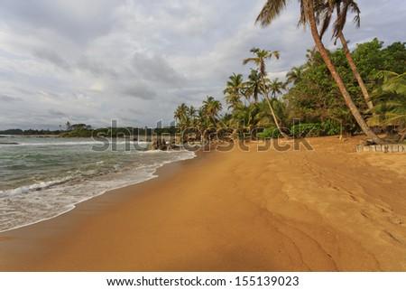 Deserted golden beach in Axim, Ghana - stock photo
