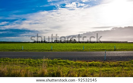 Deserted highway in the desert on a sunny day - stock photo