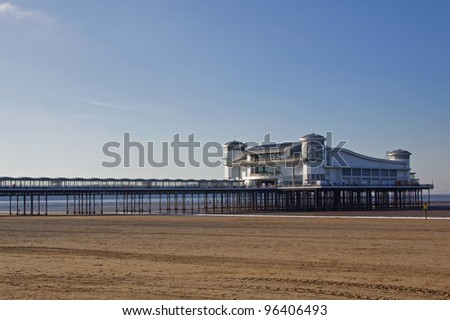 Deserted sands and pier in winter at Weston-super-Mare in the Bristol Channel UK - stock photo