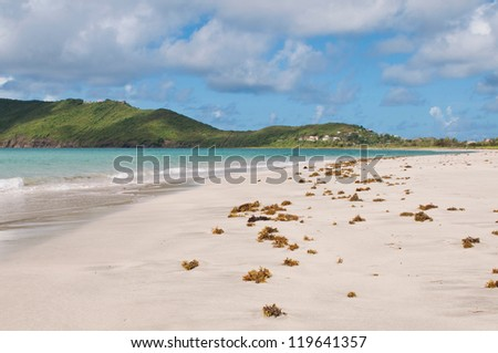 deserted sandy beach at Vieux Fort, Saint Lucia - stock photo