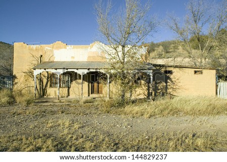 Deserted southwestern house on Mescalero Apache Indian Reservation near Ruidoso and Alto, New Mexico - stock photo