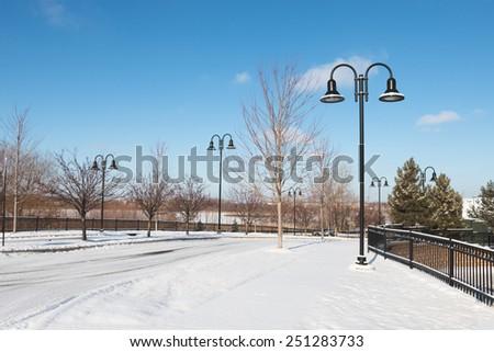 Deserted town street on winter morning, Eden Prairie, Minnesota - stock photo