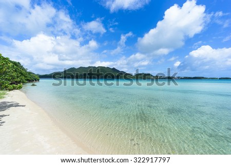 Deserted tropical beach and clear turquoise water of a coral lagoon, Kabira Bay, Ishigaki Island National Park of the Yaeyama Islands, Okinawa, Japan - stock photo