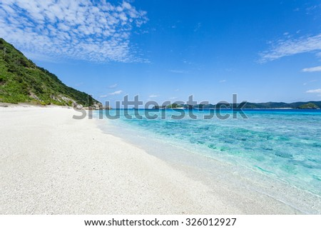 Deserted tropical beach with clear turquoise sea, Kerama Islands National Park, Okinawa, Japan - stock photo