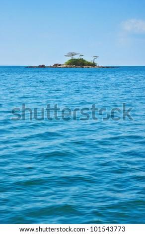 deserted tropical island - stock photo