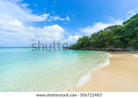 Deserted tropical island beach with clear lagoon water, Ishigaki Island National Park of the Yaeyama Islands, Okinawa, Japan - stock photo