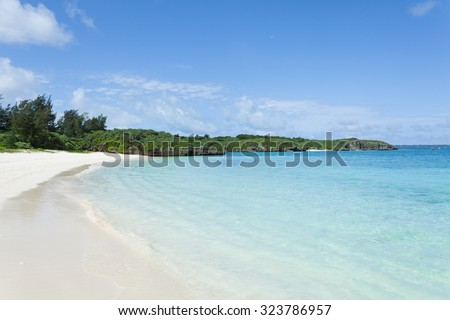 Deserted tropical Japanese beach with clear water, Miyako Island, Okinawa - stock photo