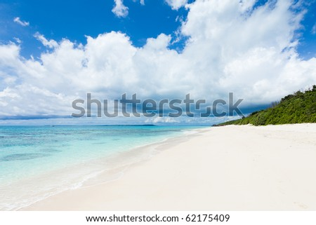 Deserted white sand tropical beach on coral island, Okinawa, Japan - stock photo