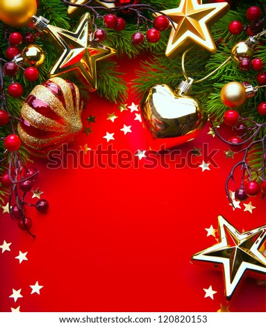 Design a Christmas greeting card with Christmas Decorations on a red background - stock photo