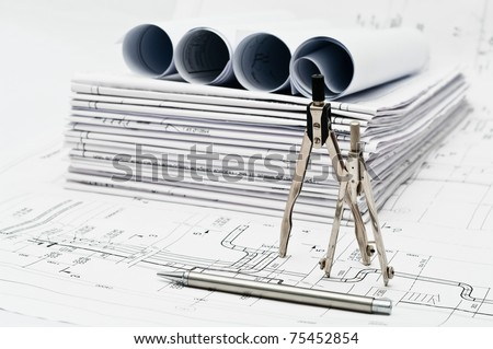 Design and working drawings with pencil and compasses - stock photo