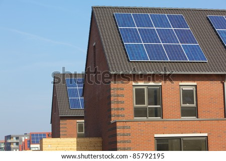 Design building with solar panels - stock photo