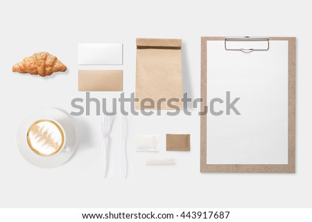 Design concept of mockup paper, bag, clipboard and coffee cup set on white background. Copy space for text and logo. Clipping Path included on white background. - stock photo
