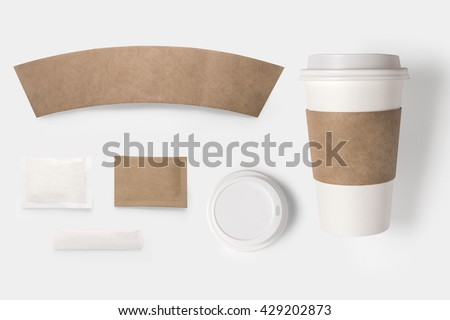 Design concept of mockup paper, sugar, coffee creamer, toothpick, lid and coffee cup set on white background. Copy space for text and logo. Clipping Path included on white background. - stock photo
