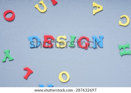 design concept with colorful foam rubber letters  - stock photo