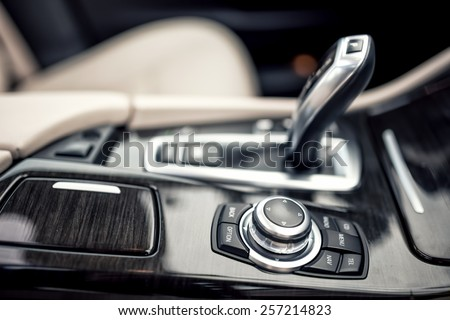 Design details of minimalist concept of modern car -  close-up details of automatic transmission and gear stick - stock photo
