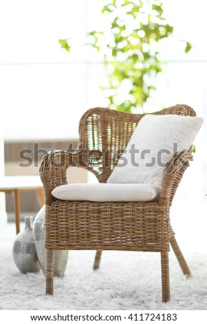 Design interior with wicker armchair indoors - stock photo
