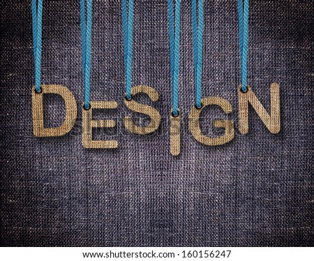 Design Letters hanging strings with blue sackcloth background. - stock photo