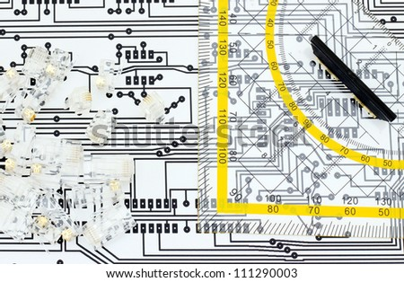 Design network concept; ruler, jacks and circuit board schema. - stock photo