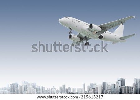 Design of commercial airliner flying above modern city - stock photo
