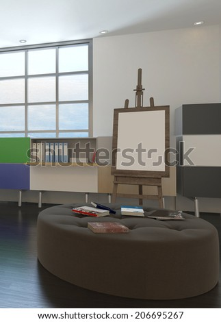 Design office interior with an easel set up in front of a large airy light window and a comfortable upholstered seating unit - stock photo