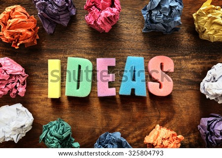 Design thought process with the word ideas and crumpled paper balls - stock photo