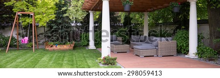 Designed arbour and see-saw in the garden - stock photo