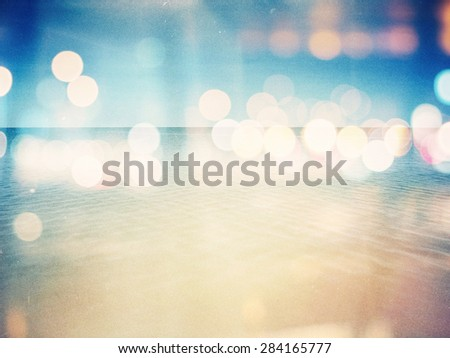 Designed retro photo background. Sunny day on the beach. Grain, dust, colors added as vintage effect. - stock photo
