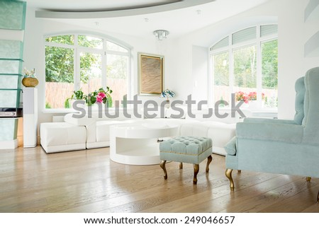 Designer armchair in luxury living room interior - stock photo