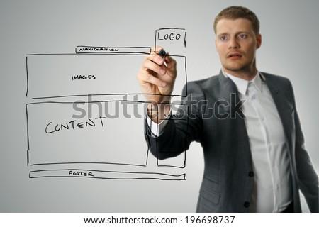 designer drawing website development wireframe - stock photo