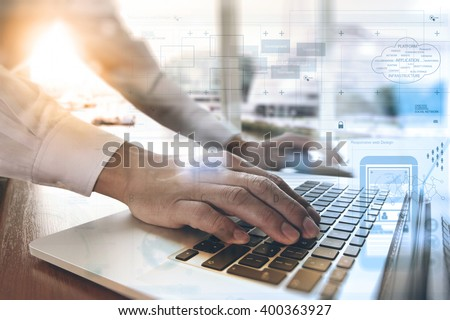 designer moving hands working with laptop computer and digital web design diagram as concept - stock photo