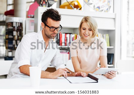 Designer signing contract. Business concept. - stock photo