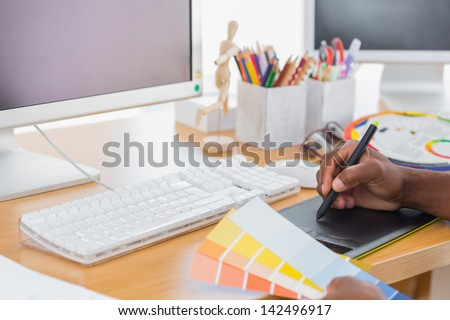 Designer using a graphics tablet in a modern office - stock photo