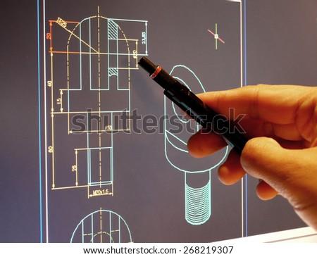 designer working on a cad blueprint  - stock photo