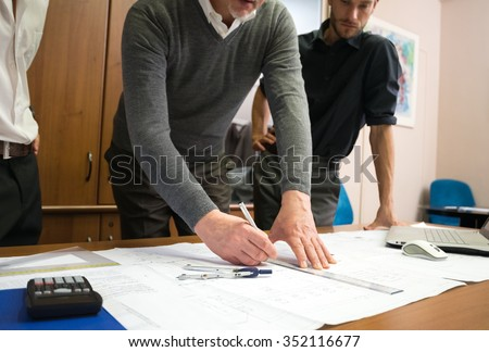 Designers at work in their office - stock photo