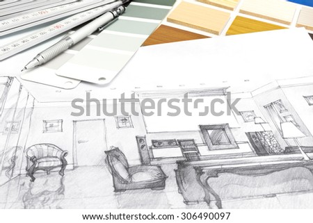 designers desk with a living room sketch and drawing tools on it - stock photo