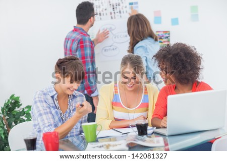 Designers having a brainstorm together in their office - stock photo