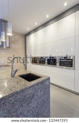 Designers interior - Closeup of kitchen interior, faucet and shelves - stock photo