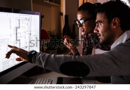 Designers working on new project.They working late into the night. - stock photo