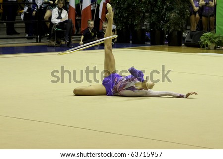 DESIO, ITALY - OCTOBER 23: Liubou Charkashyna competes in rhythm gymnastics at the A1 Italian Championship, First round on October 23, 2010 in Desio, Italy. - stock photo