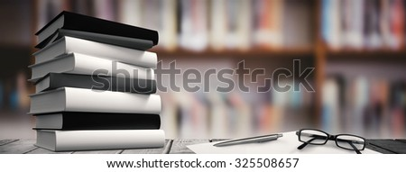 Desk against library shelf - stock photo