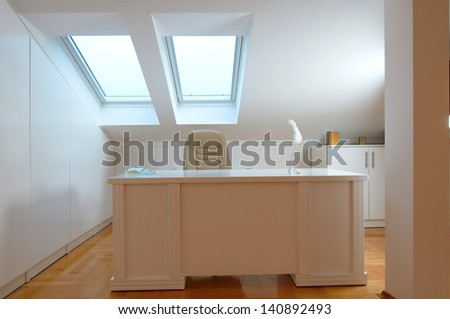 Desk and chair in a room corner - stock photo