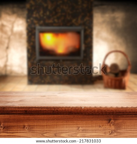 desk of wood and fireplace  - stock photo