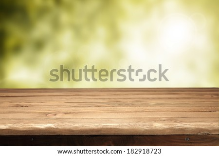 desk of wood and green space of spring or summer  - stock photo