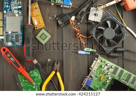 Desk technician for computers. Computer components on a workbench. Desktop clutter eletkro technology. - stock photo
