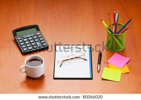 Desk top with many items - stock photo