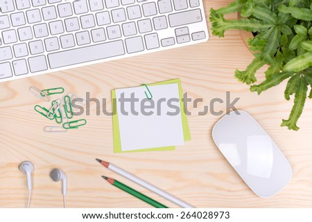 Desk with keyboard, notepaper and a cup of coffee, top view - stock photo